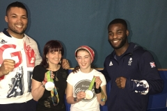 Sarah and Kira with Olympic medallists.JPG